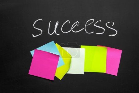 Photo for Success text with colorful stickers on chalkboard - Royalty Free Image