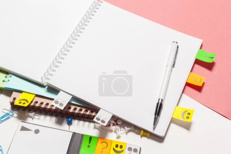 blank notebook and Colorful school supplies