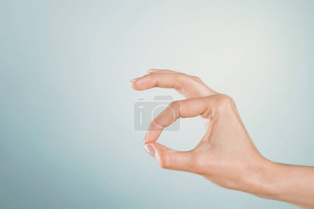 Woman Hand gesturing on colorful background