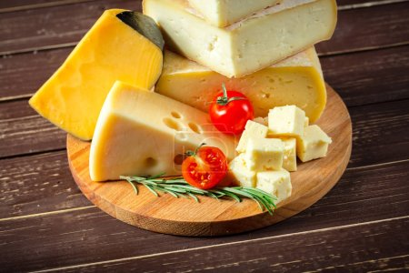 Photo for Close up of different types of cheese on wooden table - Royalty Free Image