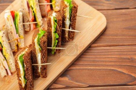 fresh italian sandwich on wooden table