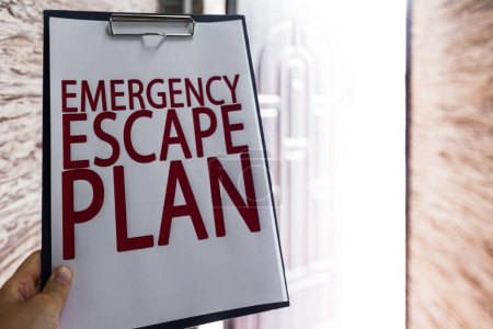 close-up of emergency evacuation plan, safety concept
