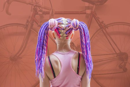 back, rear view of woman with colorful violet, pink dreadlocks.