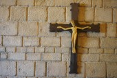 The Crucifix or cross of Jesus Christ  on brown brick wall background