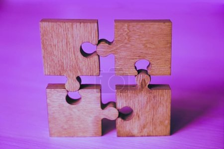 Photo for Four wooden puzzle pieces. concept of connection people - Royalty Free Image