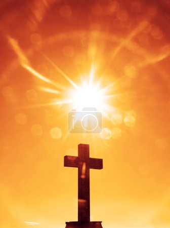 Photo for Stone cross sky with bright sunshine. Easter Symbol. - Royalty Free Image