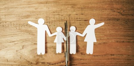 Photo for Scissors dividing  the whole family. divorce idea. wooden figures. wood background. - Royalty Free Image