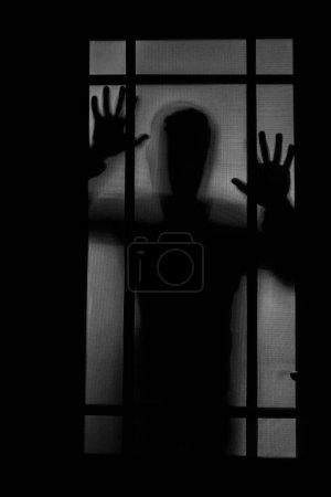 Person Schatten auf Milchglas - Gewalt Konzept Hintergrund. Schatten eines Horror-Mannes