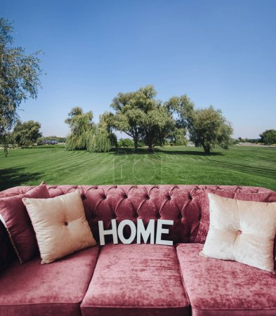Photo for Collage with sofa, home and landscape with green lawn. Concept. Soft comfortable sofa. Hygge. Home. Pink sofa made of velor. - Royalty Free Image