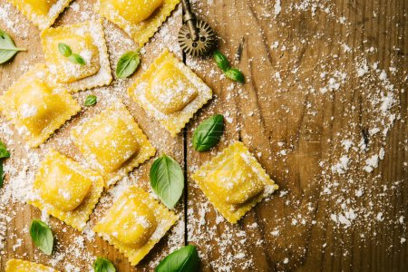 Photo for Process of cooking Italian ravioli on wooden table. Cooking process with flour. Top View with Copy Space. - Royalty Free Image