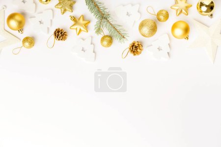 Photo for Flat Lay of Christmas golden decorative baubles and fir twig isolated on white - Royalty Free Image