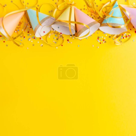 Photo for Colorful happy birthday party background with birthday hats, confetti and ribbons - Royalty Free Image