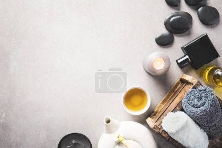Photo for Spa accessories and herbal tea on grey background - Royalty Free Image