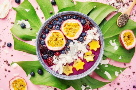 Tasty appetizing smoothie acai bowl made wild berr...