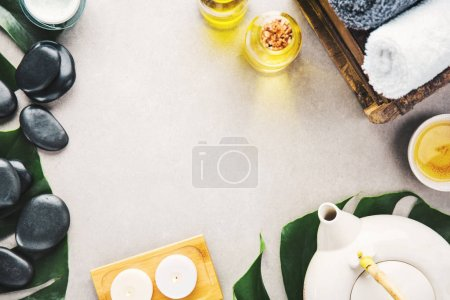 Photo pour Spa Wellness Relax concept. Spa background with spa accessories on grey background. View from above with copy space. - image libre de droit