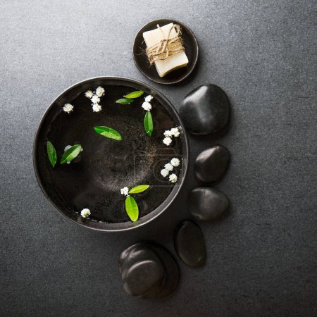Photo pour Spa Wellness Relax concept. Spa background with spa accessories on dark background. Square. - image libre de droit