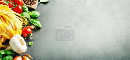 Photo for Italian food background. Healthy food background with pasta, tomatoes, basil and spices on dark background. Horizontal with copy space. - Royalty Free Image
