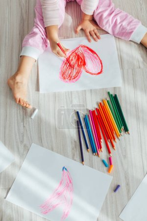 Photo for Cute little girl drawing red heart at home - Royalty Free Image