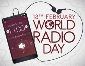 Smartphone with headphones making a heart shape with its wire and tuning a radio station with app to celebrate World Radio Day this February 13