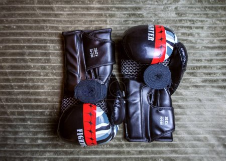 Photo for Two pair of boxing gloves 12 and 16 oz. Russia Sochi 05.12.2019 - Royalty Free Image
