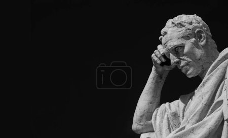 Man statue in the act of thinking against blue sky. Ancient Roman Julian the Jurist statue made at the end of 19th century in front of the Old Palace of Justice in Rome (Black and White with copy space)