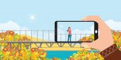 Make a photo of woman landscape by smartphone in autumn