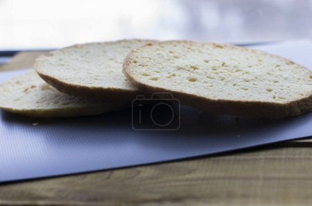 Photo for Sliced bread on black board - Royalty Free Image