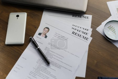 Photo for Resume (autobiography), pen, magnifier, laptop on your desktop. job search - Royalty Free Image