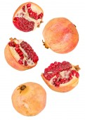 creative fruit concept. pomegranates flying in the air isolated on white with clipping path. levity concept fruit