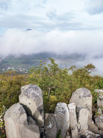 Photo for Czech milesovka mountain seen from ostry above morning fog - Royalty Free Image