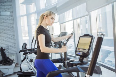 Photo for Young beautiful blond woman in the gym - Royalty Free Image