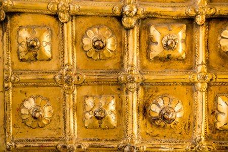 Glowing gilded door panels of former royal palace, Nepal, Hanuman Dhoka.