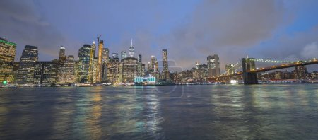 Photo for Wide view of the night New York. Seen lower Manhattan and Brooklyn Bridge. - Royalty Free Image