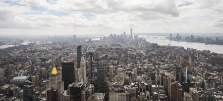 Photo for Panorama of Manhattan, skyscrapers in the distance drown in the haze of clouds. - Royalty Free Image
