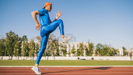 Photo for Champion young male athlete running and jogging alone along a race track in stadium while out training for marathon on a sunny day. Sport, lifestyle and people concept. - Royalty Free Image