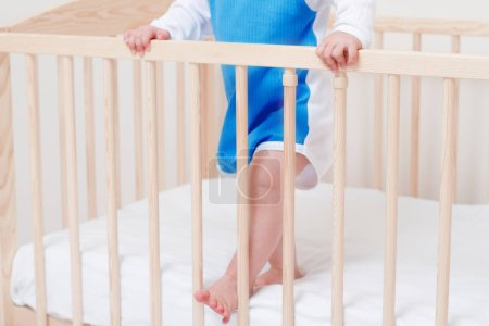 Photo for Beautiful little legs of adorable baby toddler in the white bed - Royalty Free Image