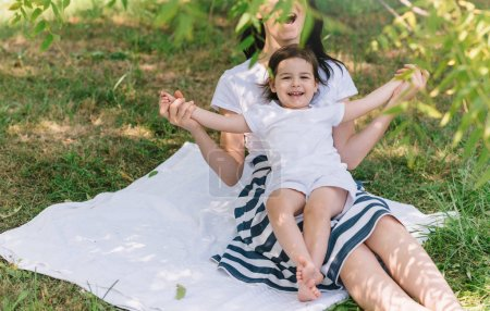 Photo for Cropped shot of fun happy smile and laughing daughter child play with mom in the park outdoor. Portrait of happy family. Happy Mother's Day. Motherhood and childhood - Royalty Free Image