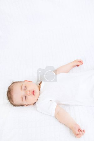 Photo for Close-up portrait of a beautiful sleeping baby on white bakcground - Royalty Free Image