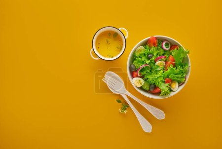 Photo for Vegetable salad with fresh lettuce, tomatoes and cucumber in pot. Top view. - Royalty Free Image