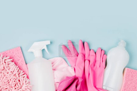 Photo for Detergents and cleaning accessories  in pink color.  Cleaning service concept. Flat lay, Top view. - Royalty Free Image