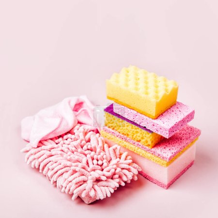 Cleaning accessories  in pink color.  Cleaning service concept. Flat lay, Top view.