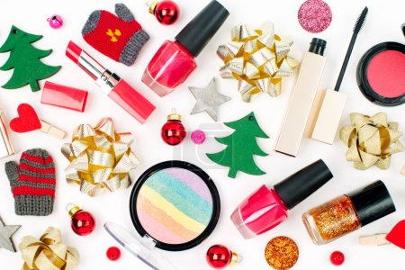 Christmas decorations and cosmetic products on white background