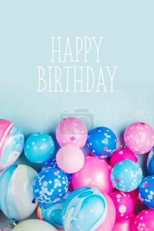 Photo for Colorful balloons on pastel blue background with happy birthday background - Royalty Free Image