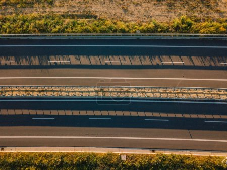 Beautiful aerial view of the highway in Italy with cars passing by.