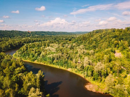 Aerial view of the Sigulda city with Gauja river and a bridge across it with cable car over the valley