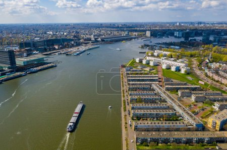 Foto de Beautiful aerial Amsterdam view from above with many narrow canals, streets and architectures. - Imagen libre de derechos