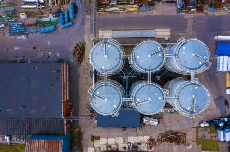 Photo for Aerial view of the industry oil barrels or chemical drums stacked up.chemical tank.container of barrels of hydrocarbons.hazardous waste of black and blue tank oil. - Royalty Free Image