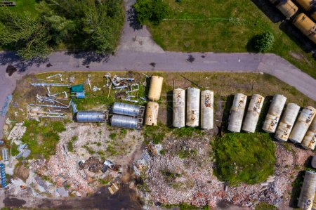 Photo for Riga, Latvia. July 10, 2020. Top aerial view of cargo trains. Aerial view from flying drone of colorful freight trains on the railway station. Wagons with goods on railroad. - Royalty Free Image