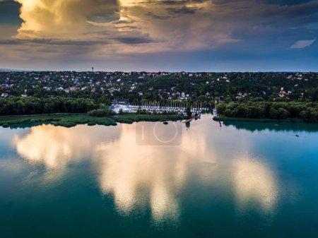 Photo for Balatonfuzfo, Hungary - Aerial view of Balatonfuzfo yacht marina at sunset with beautiful clouds and reflection on Lake Balaton - Royalty Free Image
