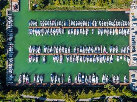 Photo for Balatonfuzfo, Hungary - Yacht marina at Balatonfuzfo by Lake Balaton from above at sunset - Royalty Free Image